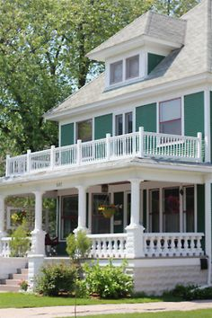 I absolutely adore second story patio/balconies on houses. It's a weakness. Also, attic rooms. and front porches.