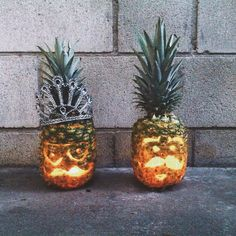 """Pin for Later: These Pineapple O'Lanterns Will Make You Forget All About Pumpkins Because of their tops, they can hold other items on their """"heads""""."""