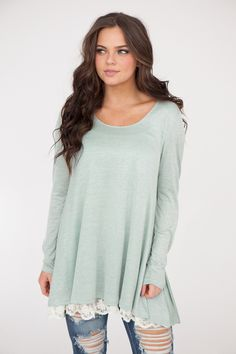 Shop our Long sleeve round neck lightweight knit tunic with feminine lace trim. Free shipping on US orders $50 & up!