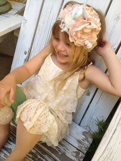 Le Bebe Cozette Couture headband is one of our latest creations made with layered flower. Embellished with silk rosettes, pearls, lace and tulle.