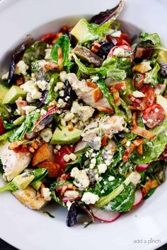 Rosemary Chicken Salad Recipe with Rosemary Ranch Dressing - Tender baked rosemary chicken is the star in this loaded salad recipe topped with a flavorful rosemary ranch dressing. The perfect combination of crunch, creamy, salty and so, so good! // addapinch.com #chickensalad #rosemarychicken #avocado #suppersalad #salads #addapinch