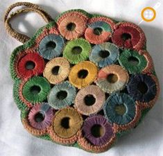 PieceWork celebrates the rich history of needlework and makers from around the globe. Whether you knit, crochet, embroider, or tat, find inspiration in the needlework traditions of the past. Crochet Coin Purse, Crochet Tote, Crochet Handbags, Crochet Purses, Crochet Earrings, Crochet Flower, Diy Crochet, Knitting Daily, Knitted Bags