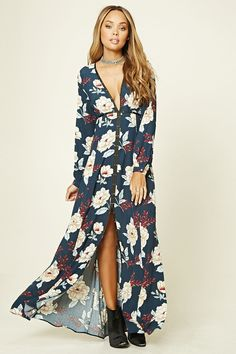 A woven maxi dress featuring a V-neckline, long button-cuff sleeves, an invisible side zipper, a split hem, contrast ribbon trim with cutout matte circle accents, and an allover floral pattern.