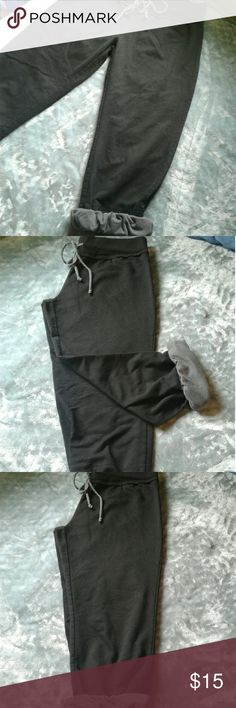 Miss Chievous joggers M Very gently pre loved womens Miss chievous black 3/4 length  joggers size Medium. Elastic drawstring waist with black/gray stripe detail drawstring and cuffs. Cuff can be worn unrolled for all black look, or roll them to show the print!! Thanks for looking!! Miss Chievous Pants Track Pants & Joggers