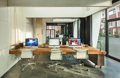 No More Working Late: At The End Of Each Day, This Office Disappears, Work-life balance by design: At 6 p.m., the desks retract up to the ceiling, making room for creative community uses and keeping staff from working too late.