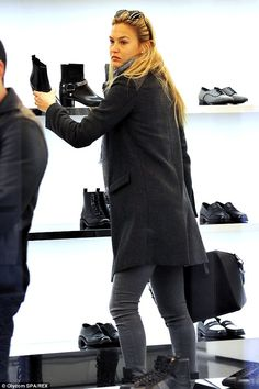 Shop till she drops: Bar Refaeli was seen looking at shoes in a shop in Milan, Italy on Friday