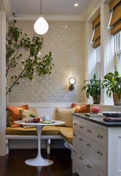 Banquette, tulip table, white kitchen: