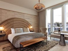 The hotel room design features custom designed furniture pieces and spacious luxury bathrooms with walk-in travertine showers and marble vanities. Tap the pin for more hotel room design, headboard ideas, bedroom furniture ideas and bedroom ideas.