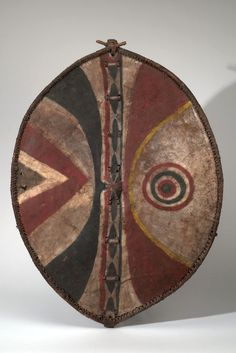 Africa | Shield from the Maasai people of Kenya | Hide, wood, pigment and leather | ca. mid 1900s