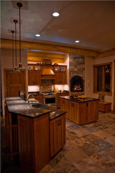Pagosa Springs Log Home #rustic kitchen possible cork floor tiles with different boxes of natural colored cork