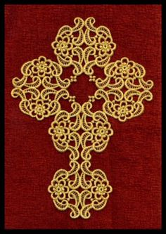 Cross created with freestanding lace motifs.