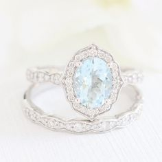 Vintage inspired bridal ring set features oval aquamarine engagement ring in ros. Wedding Rings Simple, Wedding Rings Solitaire, Classic Engagement Rings, Platinum Engagement Rings, Wedding Rings Vintage, Engagement Ring Settings, Bridal Rings, Unique Rings, Solitaire Engagement