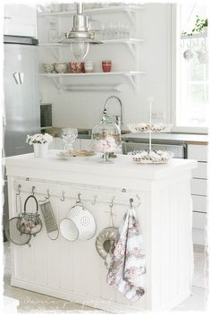 .... great kitchen island! Love The Use of a simple hook shelf for large dish storage