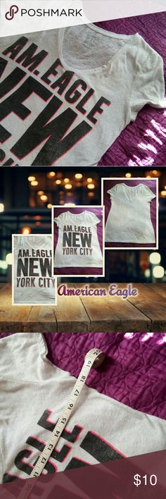 "American Eagle ""Favorite T"" tee, White, L American Eagle ""Favorite T"" tee Like New, Worn A few times, Distressed Look  Junior's Large.  In Excellent Condition.  About 18"" inch Bust, Measurements taken flat.  Loose Fit.   Made in Vietnam. Main Color: White  No Trades. Offers Are Welcomed. Thank you for stopping by! Have a Beautiful day! (: American Eagle Outfitters Tops Tees - Short Sleeve"