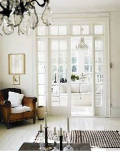 White floors, leather chair, french doors with transom. Interior Door, Interior And Exterior, Interior Design, Interior Windows, French Interior, Modern Interior, Door Design, House Design, Black And White Interior