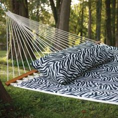 "Exotic, eye-catching Castaway Zebra-Print Hammock creates the perfect peaceful experience in a two-person design. Hammock mixes well with a variety of décors. Mildew- and stain-resistant 100% polyester. Imported. Hammock dimensions: 78""L x 52""W. Overall length: 13 feet. Weight capacity: 350 lbs."