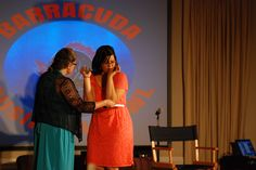Scene from the show-- A guppy demos her invention to the barracudas