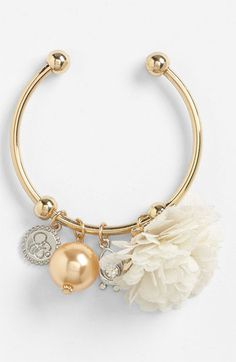 floral charm bracelet. never been into bracelets much, but i love this one
