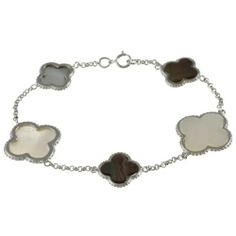 "Sterling Silver 7.25"" Black and White Mother of Pearl Clover Bracelet Beaux Bijoux. Save 44 Off!. $49.99. Gift box included. Crafted of 925 Sterling Silver. Can be delivered next Business Day!. This striking designer-inspired look is sure to impress"