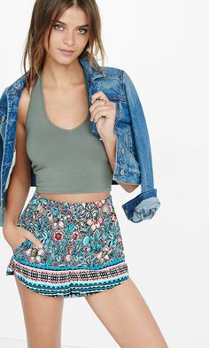 Colorfully printed soft shorts with a One Eleven crop top and a classic jean jacket make for the perfect spring break beach outfit. Add sandals for an effortless look.