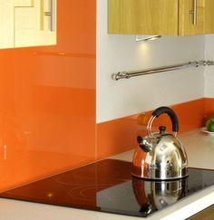 Tangerine orange kitchen glass splashback