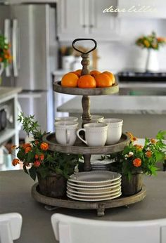Country Cottage Style | Three-tier stand with white porcelain dishes and oranges