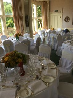 Elegant Vintage Lace Sash Bows Fitted To Bespoke White Linen Chair Covers For A Stylish Event