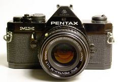 Pentax MX. It's hard for a modern DSLR user to appreciate just how small 35mm SLRs got (and how wonderful their viewfinders were) in the 80s. Delightful camera.
