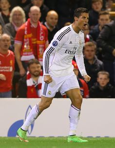 Cristiano Ronaldo of Real Madrid celebrates scoring the opening goal during the UEFA Champions League Group B match between Liverpool and Real Madrid CF on October 22, 2014 in Liverpool, United Kingdom.