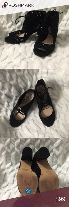 Black Vince Camuto heel NWOB Vince Camuto heel. Size 8.5 wide...fits like a 9. ZIP up back. Great detail and a cute lace up front. I'm a 9 and a bit on the narrow side and these fit great...I just have never worn them. Vince Camuto Shoes Heels
