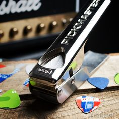 Pickmaster Plectrum Punch v2.0 / This super efficient Pickmaster Plectrum Punch v2.0 enables you to create guitar picks from practically any sheet of plastic you see around, even your old credit cards.http://thegadgetflow.com/portfolio/pickmaster-plectrum-punch-v2-0/
