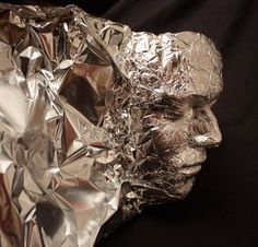 Tin Foil Head - I can see many ideas for Halloween looking at this! Never thought of using tin foil to make faces!