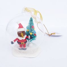 This Kiwi in a Christmas Ball Ornament is little bit different. And very cute. There's glass ball, with Santa and his tree inside. Christmas Balls, Christmas Tree, Christmas Ornaments, Kiwi Bird, Kiwiana, Gold Ribbons, Ball Ornaments, Glass Ball, Snow Globes