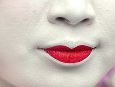 Geisha lips. Only the lower lip is painted to make the lips appear smaller.