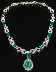 French Early to Mid 20th Century 20.00 Carat Emerald, 18.00 Carat Diamond and Platinum Lady's Drop Pendant Necklace with Detachable Pendant.  Pendant Signed with French Hallmarks .                      Lot 159