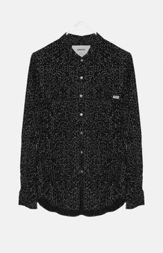 JAMES design from WeMoto is a wide cut printed shirt featuring a structured collar and two flap pockets on the chest.