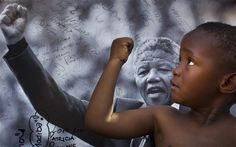 A young member of the Maitibolo Cultural Troupe, who came to dance for well-wishers in honour  of Nelson Mandela, poses for well-wishers in ...