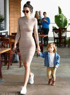Leading the way: Kendall Jenner held her niece Penelope's hand on a breakfast outing in Wo...
