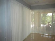 Floor to ceiling sheer verticals are the perfect solution for large windows and sliding glass doors. A self fabric valance covers the headrail and offers a finished elegant look.  www.budgetblinds.com