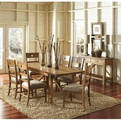 Harper    Acacia wood veneer. This casual dining collection features a trendy sandalwood wirebrushed finish on acacia veneers and rubberwood solids. The simple lines of American and French country styling accented with metal details on the table, creates a comfortable rustic feel.