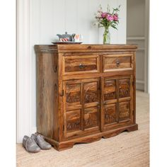 This beautiful Hathi Sideboard is hand carved from solid Sheesham hardwood. This charming sideboard has two roomy drawers and a full width cupboard