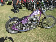 shovelhead hardtail custom with purple metal flake paintjob, Triumph MCM-style fork covers and spool front hub