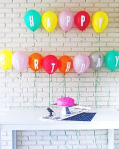 Turn plain colored balloons into an awesome eye-catching party display with this quick and easy lettered balloon banner project!