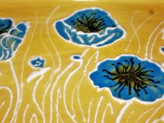 USA hand painted blue pansy ceramic bread dish with handles. All of my products are made with quality bisque and Italian glazes. We pour from our own molds and fire in our own kilns. You will find that our items are much brighter and far stronger than store bought. All glazes are food and dishwasher safe.