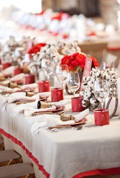 from blogger bailey mccarthy's welcome reception.  loving the cotton ball and red ranunculous centerpieces along with the cow bells and the tin mugs