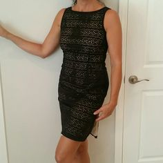 NWT Black cut out dress with nude lining Never worn little black dress.100% cotton with acetate lining.  Cut out design with a nude lining so nothing is see through. With a V back and a side slit. Perfect condition. Comes from a super clean and smoke free home. ESPRIT Dresses