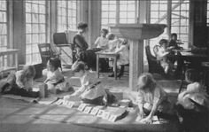 Children working independently in a typical Montessori environment as the Directress or Guide observes the children and facilitates when necessary.