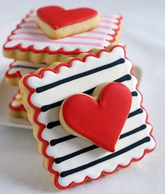 "Double-decker Valentine's cookies (recipe on the ""Bake at 350"" blog). Something similar (more rectangular) to the scalloped square cutter is included in Williams Sonoma's ""Message in a Cookie"" kit.  You could ice it to look like a stamp?  Or continue the stripes across the heart (and make them wavy) to make the stamp look cancelled?  (My stripes would be wavy anyway. :) )"