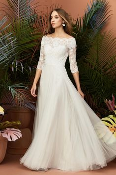d3001adccfcf This A-line wedding dress features a bateau off-the-shoulder neckline,  corded Alencon lace bodice and sleeves, soft netting skirt, and grosgrain  ribbon at ...