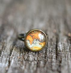 This beautiful antique map ring is made from a high quality vintage map print attached to a bronze adjustable ring. It is sealed with a 12 mm glass dome that also magnifies the print. The ring is lead